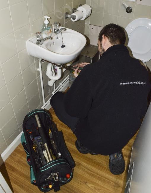 Reactive 02 plumber repairing sink
