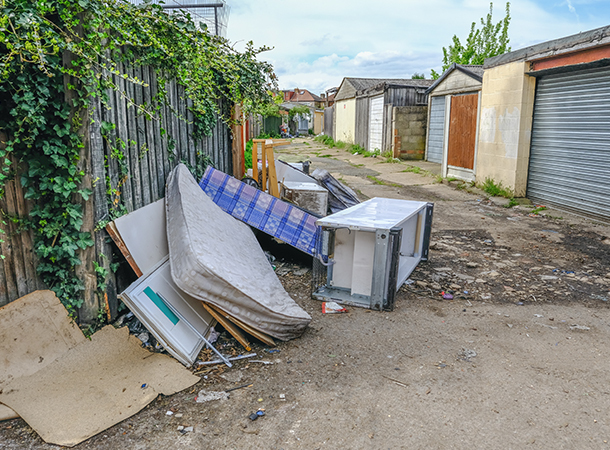 alleyway with fly-tipped waste